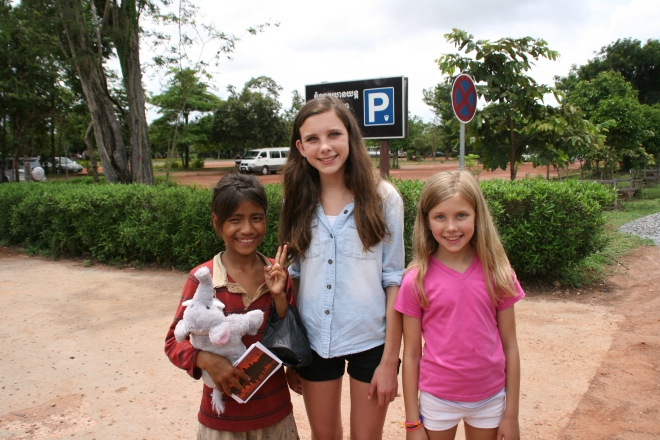 My daughters enjoying a happy moment with a young Cambodian girl we met outside one of the temples. Many children in Cambodia do not go to school because their parents need them to help make money, usually selling trinkets to tourists. We did not buy anything from the children, but we did give this girl a cute stuffed animal.